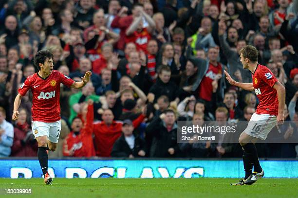 Shinji Kagawa of Manchester United celebrates scoring his side's second goal with team mate Michael Carrick during the Barclays Premier League match...