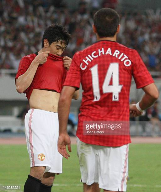Shinji Kagawa of Manchester United celebrates scoring their first goal during the preseason friendly match between Shanghai Shenhua and Manchester...