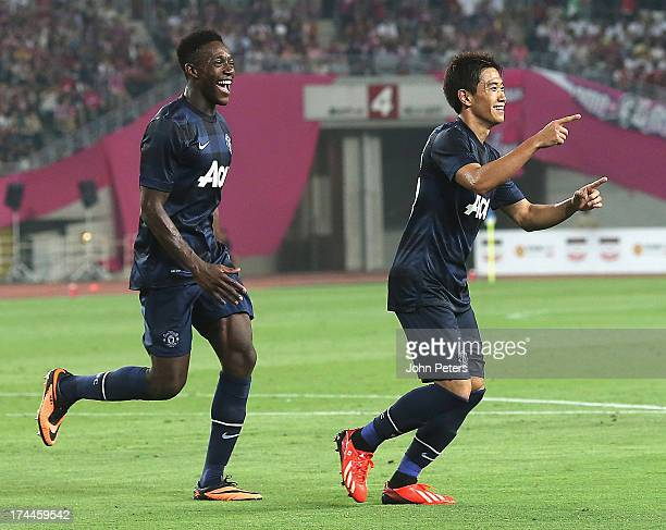 Shinji Kagawa of Manchester United celebrates scoring their first goal during the pre-season friendly match between Cerezo Osaka and Manchester...