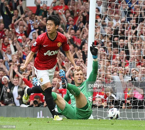 Shinji Kagawa of Manchester United celebrates scoring their second goal during the Barclays Premier League match between Manchester United and Fulham...