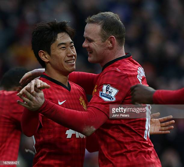 Shinji Kagawa of Manchester United celebrates scoring their third goal during the Barclays Premier League match between Manchester United and Norwich...