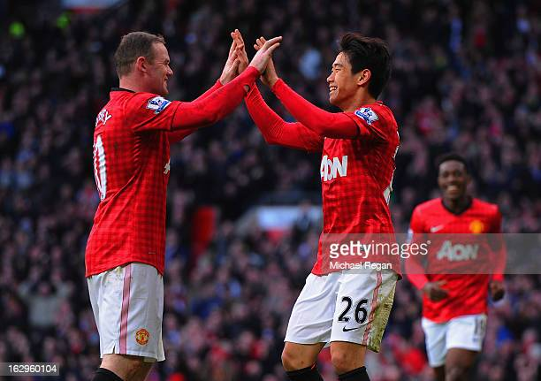 Shinji Kagawa of Manchester United celebrates scoring to make it 2-0 with team mate Wayne Rooney during the Barclays Premier League match between...