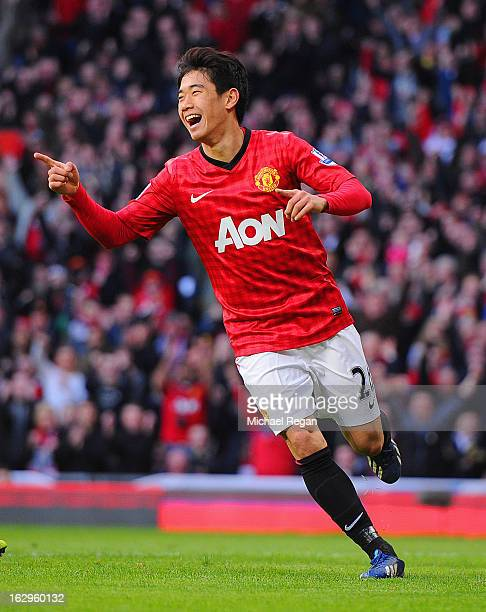 Shinji Kagawa of Manchester United celebrates scoring to make it 2-0 during the Barclays Premier League match between Manchester United and Norwich...
