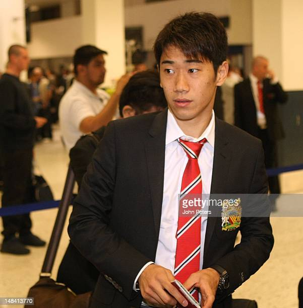 Shinji Kagawa of Manchester United checks in for the club's preseason tour of South Africa and China at Manchester Airport on July 16 2012 in...