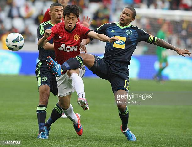 Shinji Kagawa of Manchester United clashes with Granwald Scott of Ajax Cape Town during the preseason friendly match between Ajax Cape Town and...