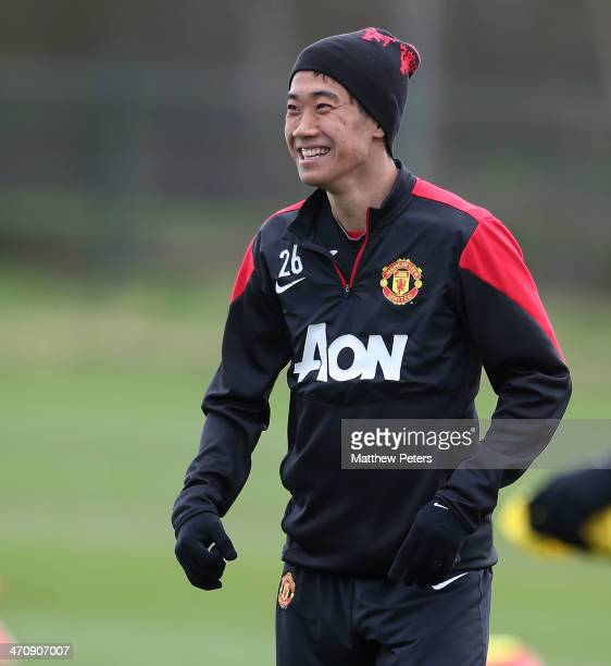 Shinji Kagawa of Manchester United in action during a first team training session at Aon Training Complex on February 21, 2014 in Manchester, England.