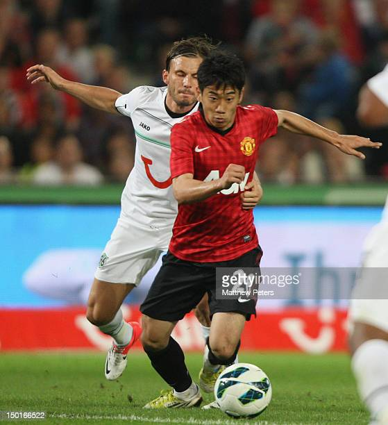Shinji Kagawa of Manchester United in action during the pre-season friendly match between Hannover 96 and Manchester United at AWD Arena on August...