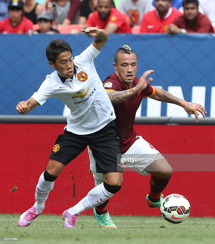 Shinji Kagawa of Manchester United in action with Radja Nainggolan of AS Roma during the pre-season friendly match between Manchester United and AS Roma at Sports Authority Field at Mile High on July 26, 2014 in Denver, Colorado.