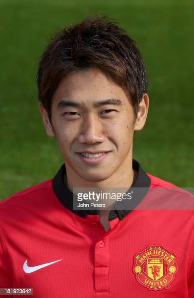Shinji Kagawa of Manchester United poses at the annual club photocall at Old Trafford on September 26 2013 in Manchester England