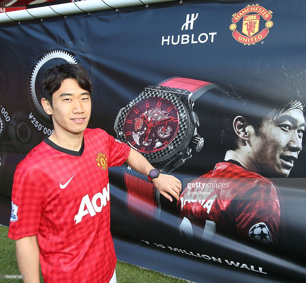 Shinji Kagawa of Manchester United poses with a Hublot watch before taking part in a charity shooting event at Old Trafford on March 12, 2013 in Manchester, England.