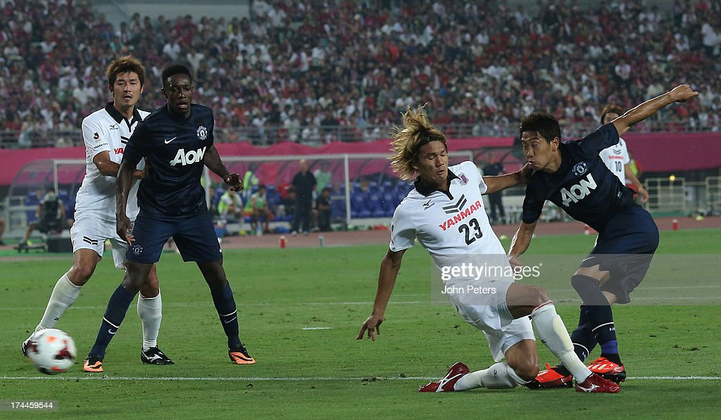 Shinji Kagawa of Manchester United scores their first goal during the pre-season friendly match between Cerezo Osaka and Manchester United as part of their pre-season tour of Bangkok, Australia, Japan and Hong Kong at Nagai Stadium on July 26, 2013 in Osaka, Japan.