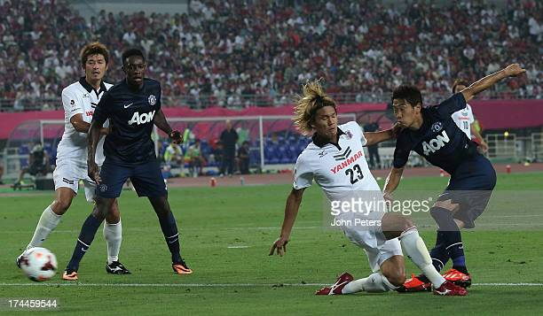 Shinji Kagawa of Manchester United scores their first goal during the pre-season friendly match between Cerezo Osaka and Manchester United as part of...