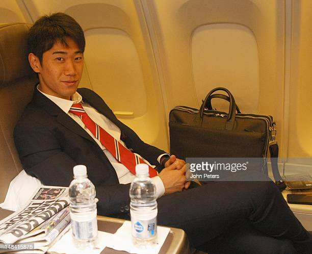 Shinji Kagawa of Manchester United sits on the plane ahead of the club's preseason tour of South Africa and China at Manchester Airport on July 16...