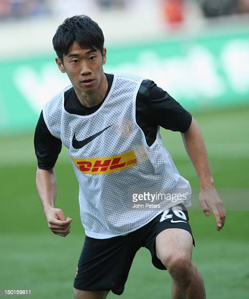 Shinji Kagawa of Manchester United warms up ahead of the pre-season friendly match between Hannover 96 and Manchester United at AWD Arena on August...