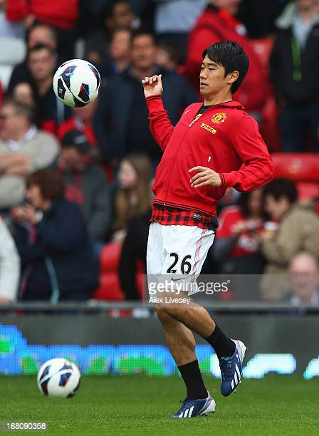Shinji Kagawa of Manchester United warms up prior to the Barclays Premier League match between Manchester United and Chelsea at Old Trafford on May 5...