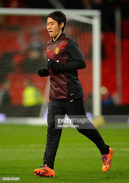 Shinji Kagawa of Manchester United warms up prior to the Barclays Premier League match between Manchester United and Cardiff City at Old Trafford on...