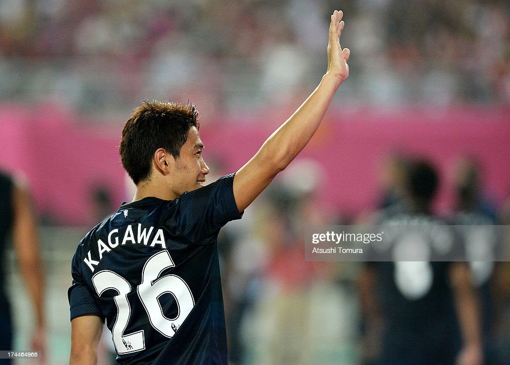 Shinji Kagawa of Manchester United waves to fans after the pre-season friendly match between Cerezo Osaka and Manchester United at Nagai Stadium on July 26, 2013 in Osaka, Japan.