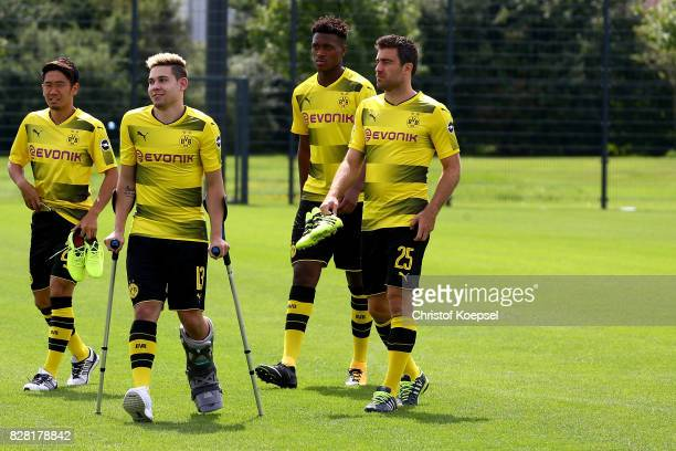 Shinji Kagawa Raphael Guerreiro DanAxel Zagadou and Sokratis of Borussia Dortmund on the way to the team presentation at Brackel Training Ground on...