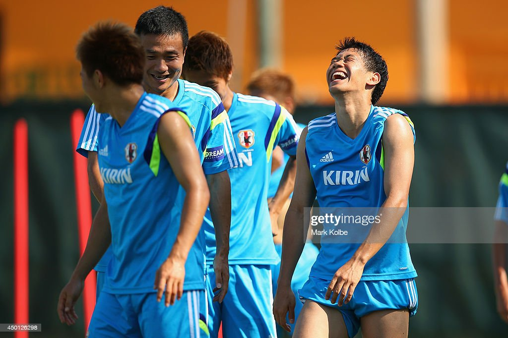 Shinji Kagawa shares a laugh with a team mate during a Japan training session at North Greenwood Recreation & Aquatic Complex on June 5, 2014 in Clearwater, Florida.