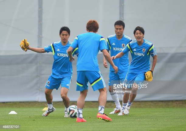 Shinji Kagawa Yuka Osako Yasuyuki Konno and Atsuto Uchida of Japan in action during the training session on May 22 2014 in Ibusuki Kagoshima Japan
