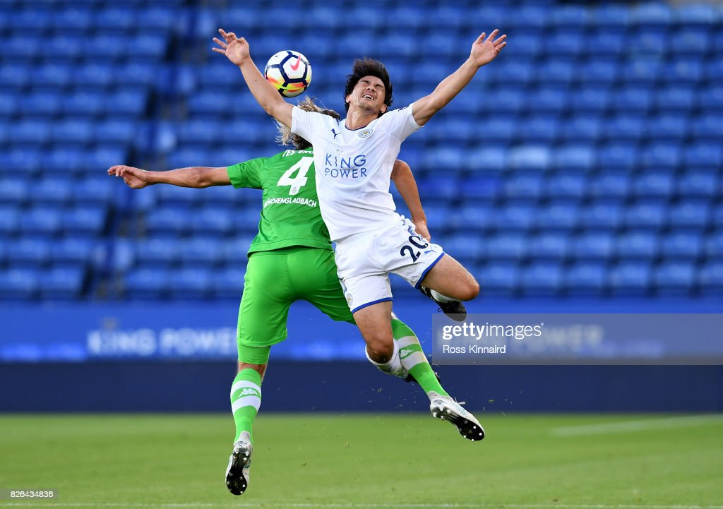 Shinji Okazak of Leicester is challenged by Jannik Vestergaard of Borussia Moenchengladbach during the preseason friendly match between Leicester City and Borussia Moenchengladbach at The King Power Stadium on August 4, 2017 in Leicester, United Kingdom.
