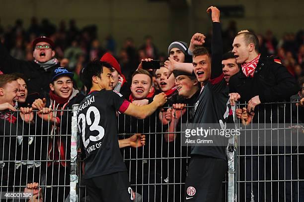 Shinji Okazaki and Benedikt Saller of Mainz celebrate with the fans after the Bundesliga match between VfB Stuttgart and 1 FSV Mainz 05 at...