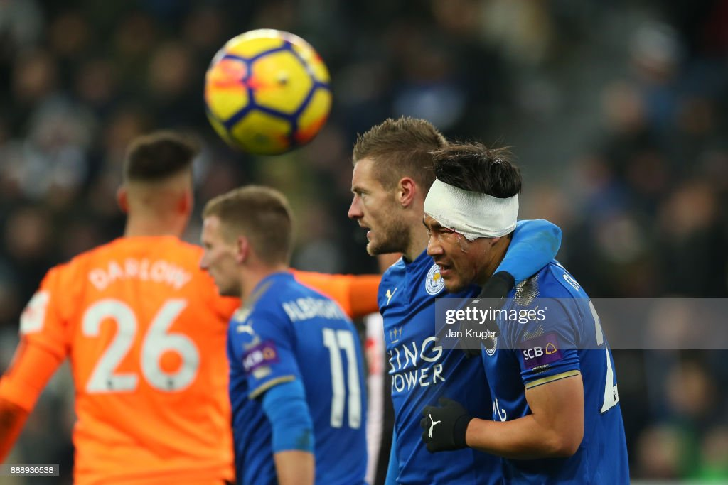 Shinji Okazaki and Jamie Vardy of Leicester City celebates after Leicester City's third goal during the Premier League match between Newcastle United and Leicester City at St. James Park on December 9, 2017 in Newcastle upon Tyne, England.