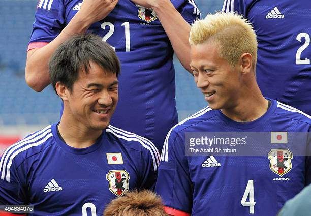 Shinji Okazaki and Keisuke Honda of Japan talk during the photo session prior to an offcial training session ahead of the international friendly...