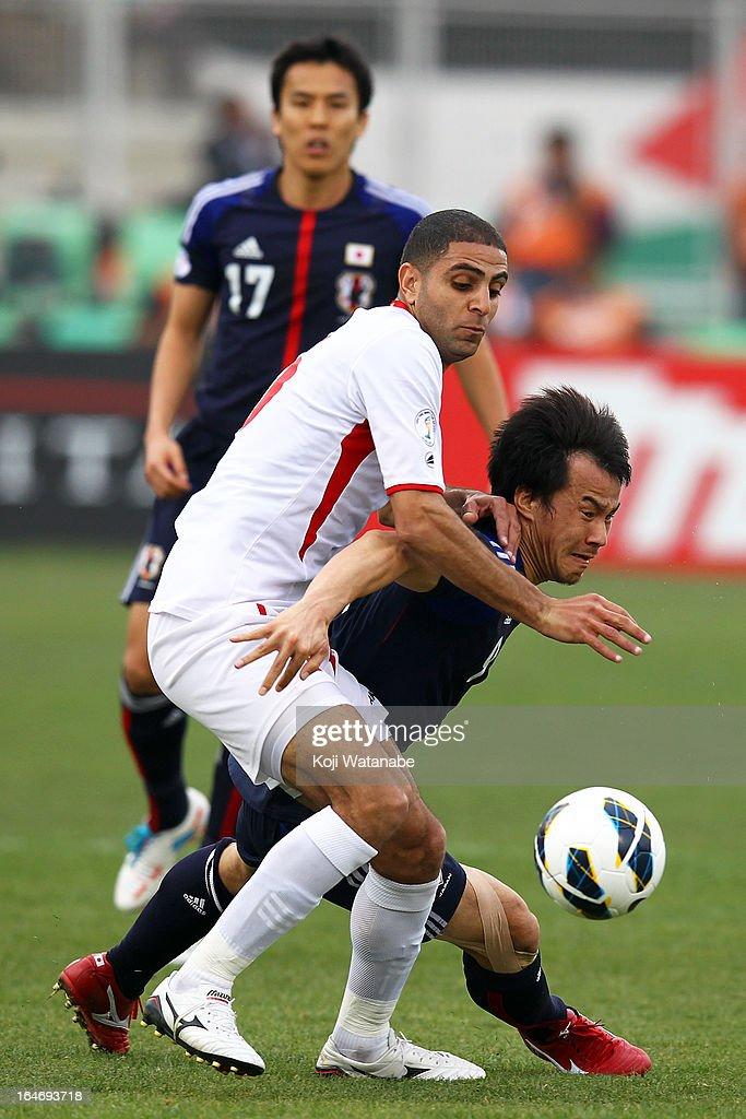 Shinji Okazaki and Odai Alsaify of Jordan compete for the ball during the FIFA World Cup Asian qualifier match between Jordan and Japan at King Abdullah International Stadium on March 26, 2013 in Amman, Jordan.