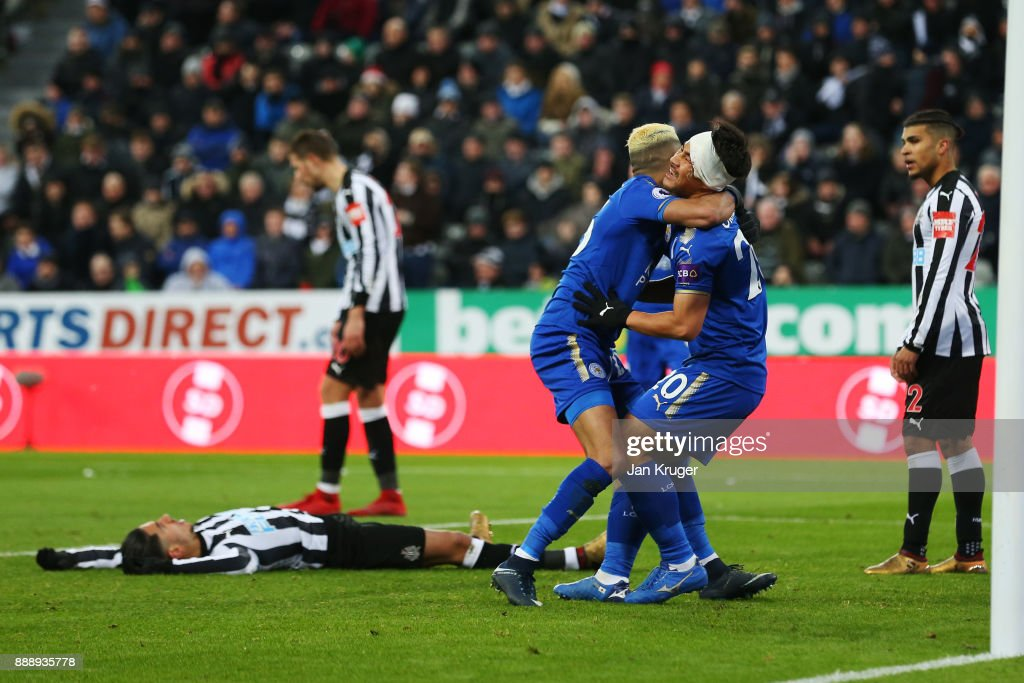 Shinji Okazaki and Riyad Mahrez of Leicester City celebrate after Ayozi Perez of Newcastle United scores an own goal during the Premier League match between Newcastle United and Leicester City at St. James Park on December 9, 2017 in Newcastle upon Tyne, England.