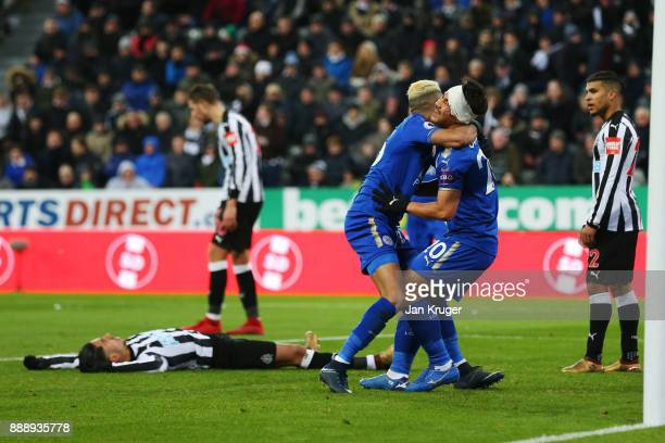 Shinji Okazaki and Riyad Mahrez of Leicester City celebrate after Ayozi Perez of Newcastle United scores an own goal during the Premier League match...