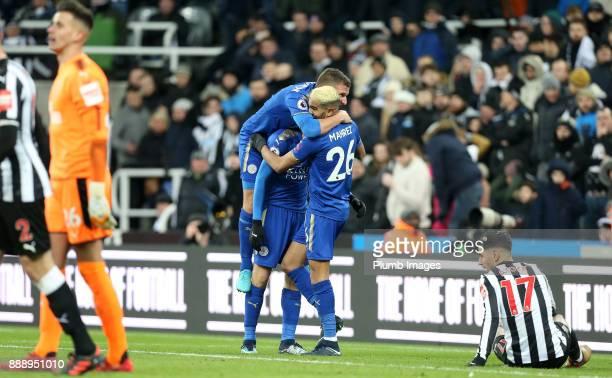 Shinji Okazaki Marc Albrighton and Riyad Mahrez of Leicester City celebrate after an own goal goal by Ayoze Perez of Newcastle United to make it 31...