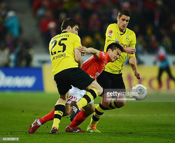 Shinji Okazaki of 1 FSV Mainz 05 is challenged by Sokratis and Sebastian Kehl of Borussia Dortmund during the Bundesliga match between 1 FSV Mainz 05...