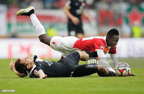 Shinji Okazaki of FSV Mainz 05 is flattened by Abdul Rahman Baba of FC Augsburg in the Bundesliga match betwen FC Augsburg and FSV Mainz 05 at SGL...