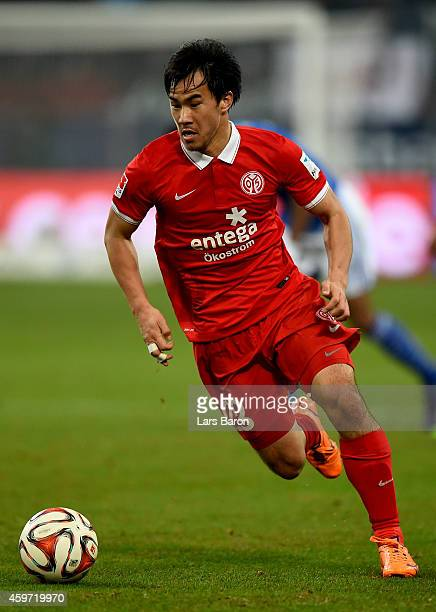 Shinji Okazaki of FSV Mainz 05 runs with the ball during the Bundesliga match between FC Schalke 04 and FSV Mainz 05 at Veltins Arena on November 29,...