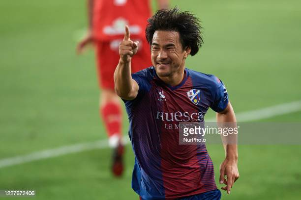 Shinji Okazaki of Huesca celebrates after scoring his sides first goal during the La Liga Smartbank match between SD Huesca and CD Numancia at...