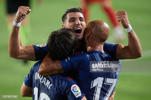 Shinji Okazaki of Huesca celebrates with Rafa Mir after scoring his sides first goal during the La Liga Smartbank match between SD Huesca and CD...