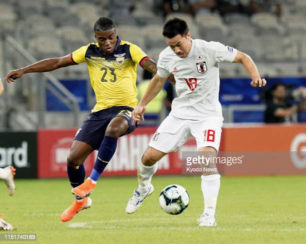 Shinji Okazaki of Japan and Jhegson Sebastian Mendez of Ecuador vie for the ball during the first half of a 11 draw in a Copa America Group C match...