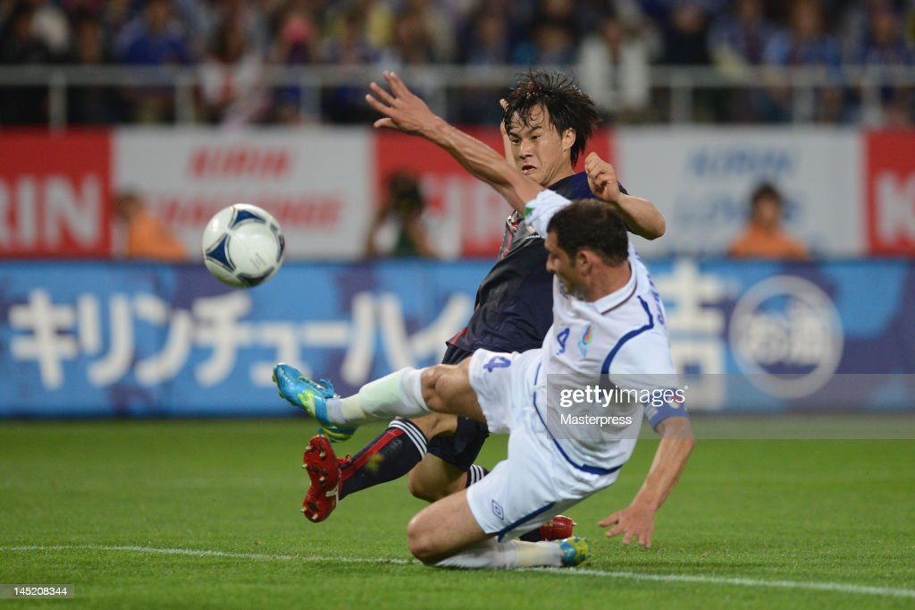 Shinji Okazaki of Japan and Mahir Shukurov of Azerbaijan compete for the ball during the international friendly match between Japan and Azerbaijan at Ecopa Stadium on May 23, 2012 in Kakegawa, Japan.