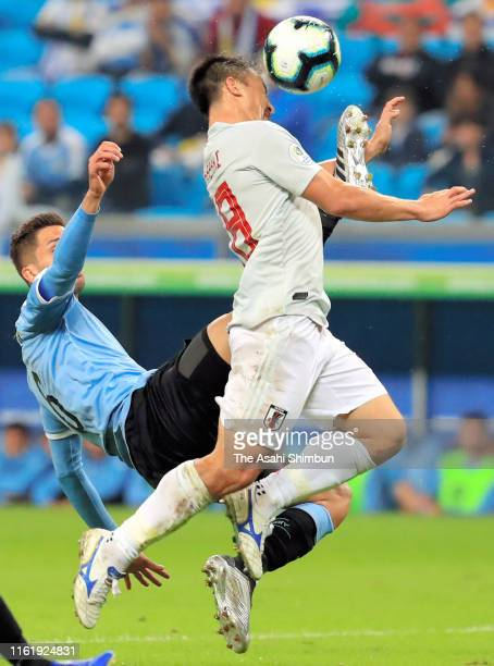 Shinji Okazaki of Japan and Rodrigo Bentancur of Uruguay compete for the ball during the Copa America Brazil 2019 group C match between Uruguay and...