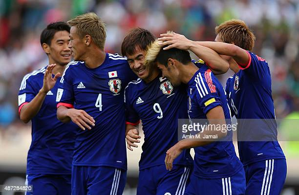 Shinji Okazaki of Japan celebrates a goal with his team mates during the 2018 FIFA World Cup Russia qualifier against Afghanistan at Azadi Stadium on...