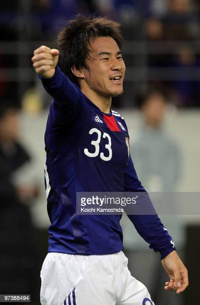Shinji Okazaki of Japan celebrates after scoring his team's first goal during the AFC Asian Cup Qatar 2011 Group A qualifier football match between...