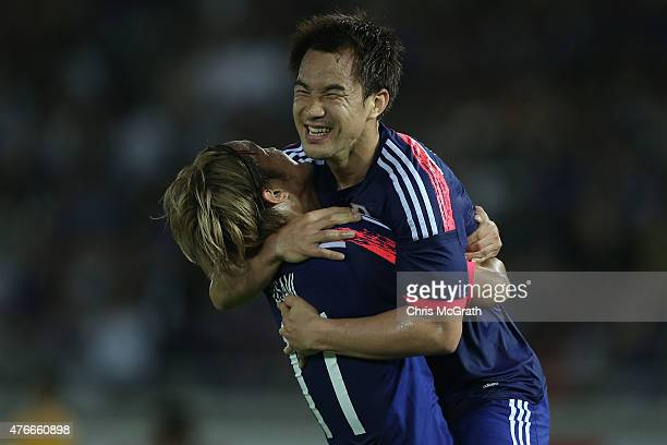 Shinji Okazaki of Japan celebrates scoring a goal with team mate Takashi Usami during the international friendly match between Japan and Iraq at...