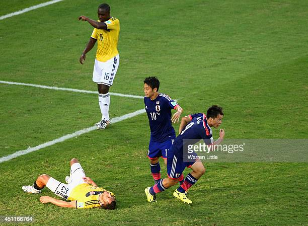Shinji Okazaki of Japan celebrates scoring his team's first goal during the 2014 FIFA World Cup Brazil Group C match between Japan and Colombia at...
