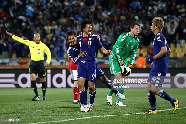 Shinji Okazaki of Japan celebrates scoring his team's third goal with Keisuke Honda during the 2010 FIFA World Cup South Africa Group E match between...