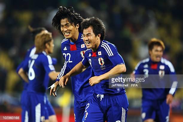 Shinji Okazaki of Japan celebrates scoring with teammate Yuji Nakazawa during the 2010 FIFA World Cup South Africa Group E match between Denmark and...
