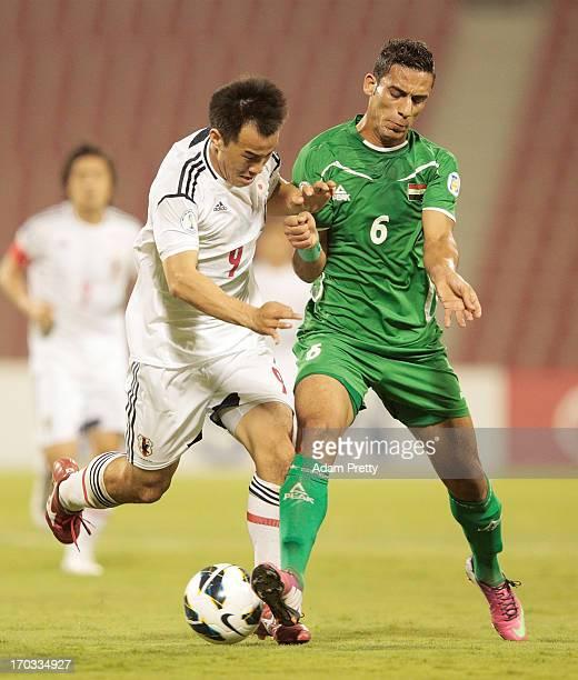 Shinji Okazaki of Japan challenges Ali Adnan of Iraq during the FIFA World Cup Asian qualifier match between Iraq and Japan at AlArabi Stadium on...