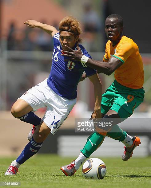 Shinji Okazaki of Japan competes for the ball against Ismael Tiote of Ivory Coast during the Japan v Ivory Coast International Friendly match at...