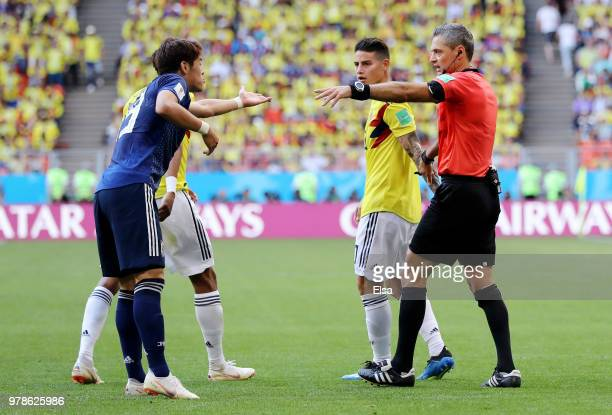 Shinji Okazaki of Japan confronts James Rodriguez of Colombia as referee Damir Skomina gives instructions during the 2018 FIFA World Cup Russia group...