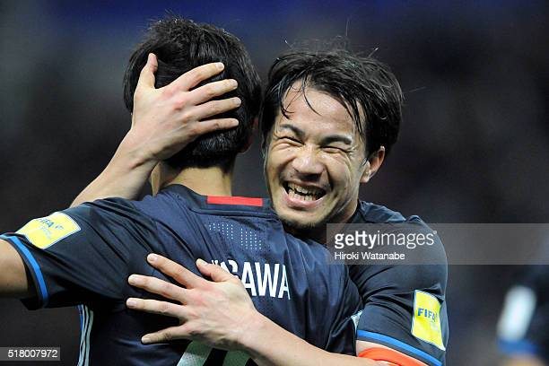 Shinji Okazaki of Japan congratulates his team mate Shinji Kagawa during the FIFA World Cup Russia Asian Qualifier second round match between Japan...